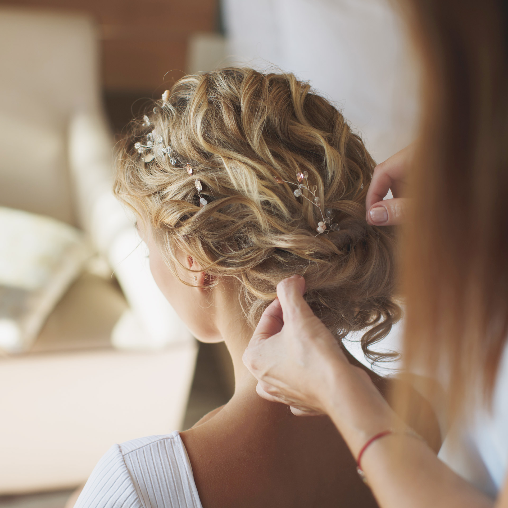 Woman getting her hair styled for her wedding