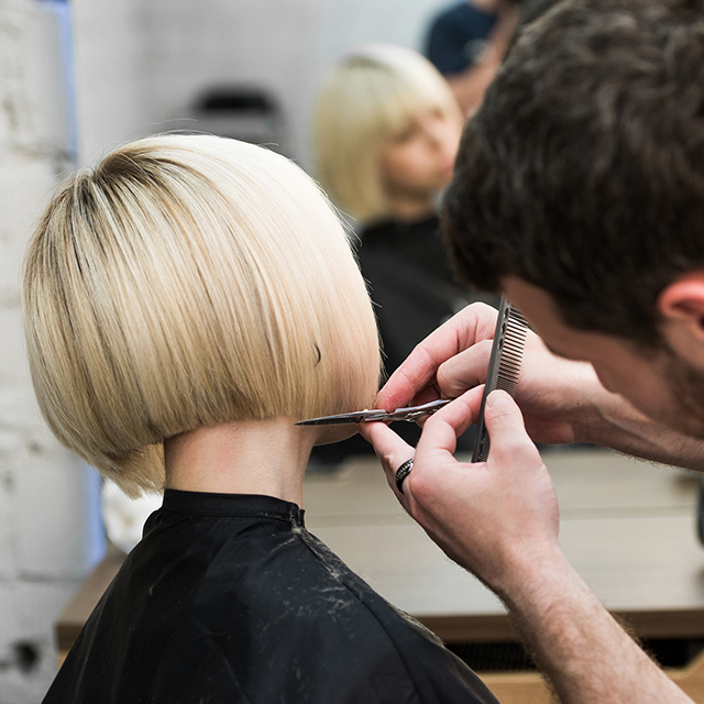 Woman getting stylish haircut